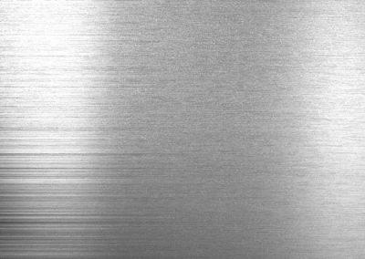 Alusplash kitchen and bathroom splashback, grey sample of Silver brushed splashback from the Essentials Collection