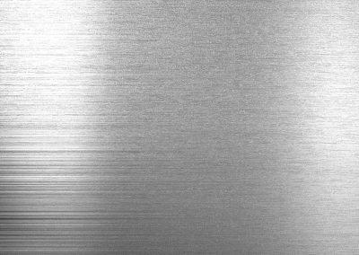 Alusplash kitchen and bathroom splashback, grey sample of Silver Brushed splashback from the Elegance Collection