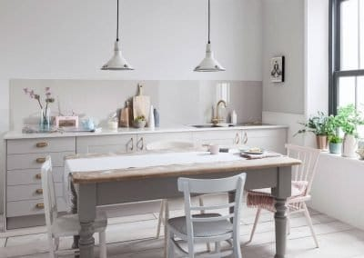 Rustic kitchen with a Warm Grey Alusplash splashback and wooden dining table with potted herbs