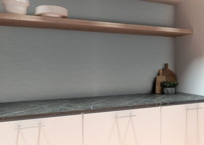 Kitchen with a silver brushed grey Alusplash splashback and black textured marble kitchen countertop with plates and bowls