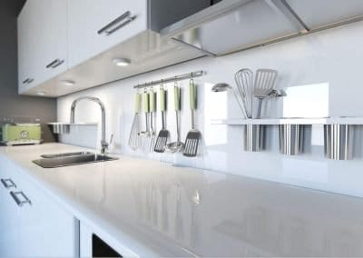 Ice white kitchen cabinets with an ice white Alusplash splashback and kitchen tools