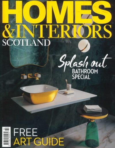 Alusplash splashbacks featured on Homes and Interiors magazine. Magazine cover showing a modern splashback for bathroom with rich color combinations