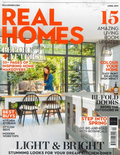 Alusplash splashbacks featured on Real homes magazine. Magazine cover showing an amazing living room updates and kitchen storage with modern worktops and inspiring home makeovers