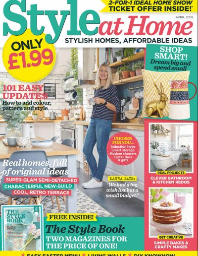 Alusplash splashbacks featured on Style at home magazine. Magazine cover showing a clever bathrooms and kitchen redos with a girl standing near dining table