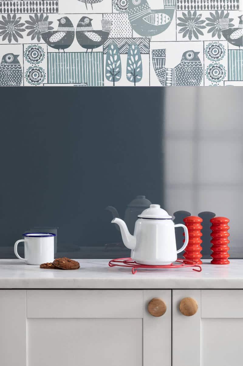High gloss Petrol Blue Alusplash splashback from the Elegance Collection with a British high tea set
