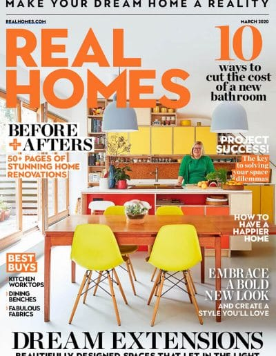 Alusplash splashbacks featured on Real Home. magazine cover showing ways to cost cutting new bathrooms with stylish kitchen worktops and dining benches