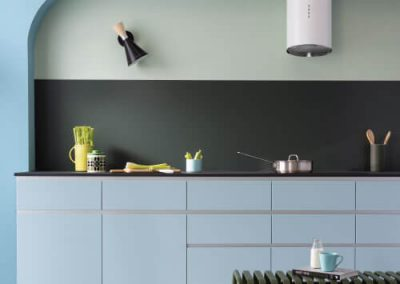Ice blue futuristic kitchen with a Forest Green Alusplash splashback from the matt Elements Collection and black countertop with a kitchen accessories