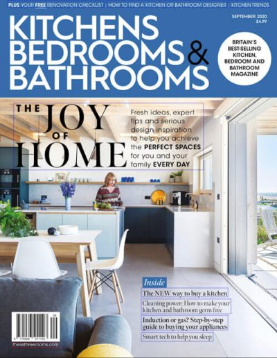 Alusplash splashbacks featured on Kitchen Bedrooms & Bathrooms magazine. Cover showing a minimalistic black and white kitchen and a lady cooking