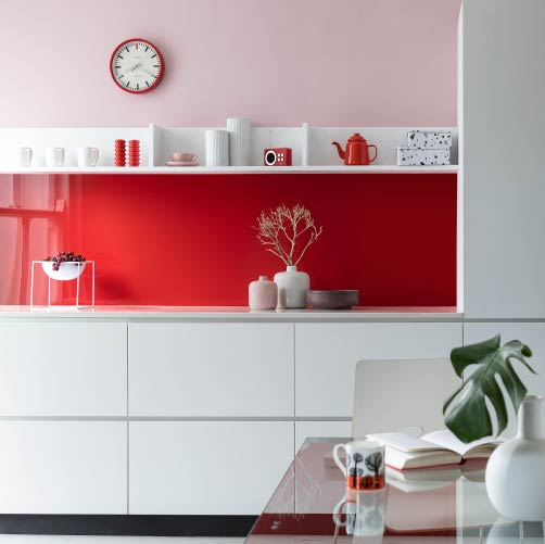 Red Kitchen backsplash in a modern white kitchen