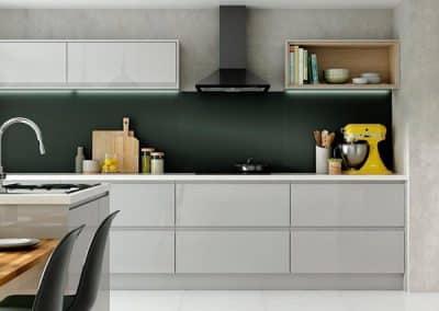 Alusplash kitchen backsplash in matt green featured in a modern glossy kitchen from Wickes