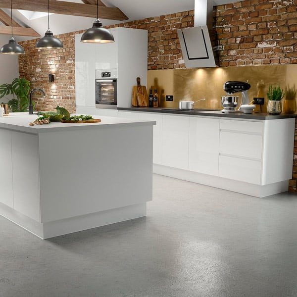 Wooden kitchen cabinets with a high gloss olive green Alusplash splashback and wooden countertop with wooden utensils